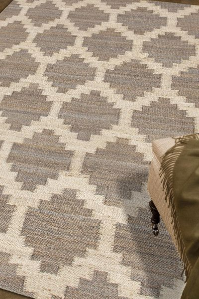 Simple patterns in two color combinations are used to create this collection of chunky woven jute rugs. Hardy and durable these fringed rug enhance both rustic