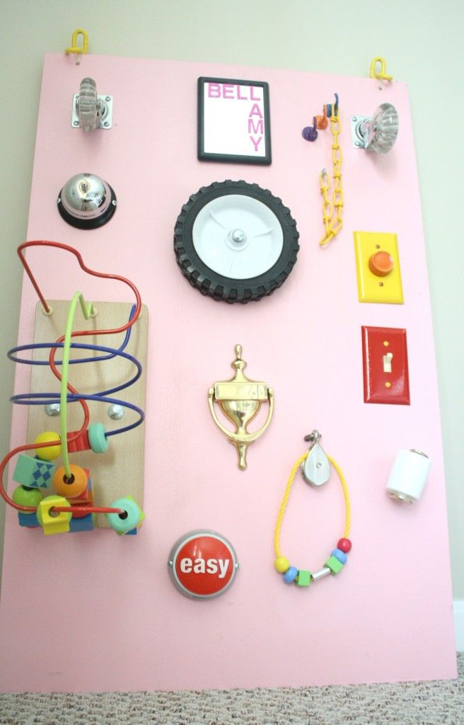 A DIY Toddler Busy Board!  I am so doing this!  Great idea to connect it to the wall and repurpose all of these items! Plus it will improve gross motor skill development.  Love it!