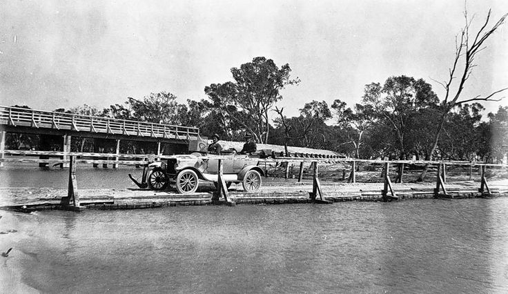 Two bridges on Outlet Creek. The old bridge, in the foreground, is at water level and carries a motor car. The new bridge, in the background, Lake Hindmarsh, 1920.