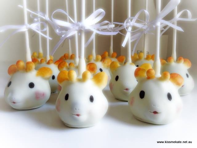 Cute idea from Kiss Me Kate - Sophie Giraffe cake pops.  Think the babies will get a shock when they can actually eat Sophie!