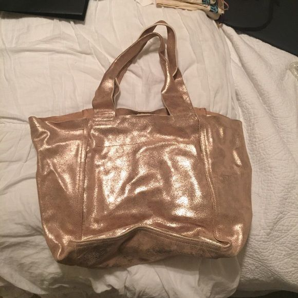 GAP Gold Metallic Suede Tote Bag GAP gold metallic tote bag with tan suede interior. Magnetic closure. Bag is in great condition! GAP Bags Totes