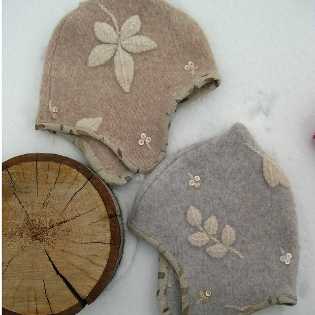 These have beautiful wool applique, sequins and hand printed linen trim