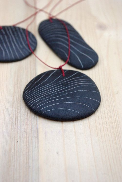 Ceramic pendant - black with fine white lines. €17.50, via Etsy.