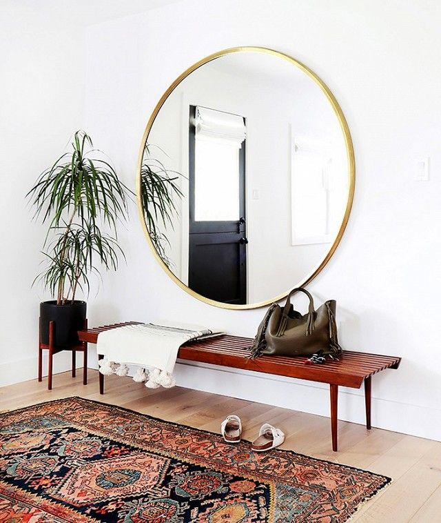A large entryway mirror sets the tone for a chic and minimalist home. With a gorgeous gold border, this round mirror is love at first sight for guests as they arrive. It's also never a...