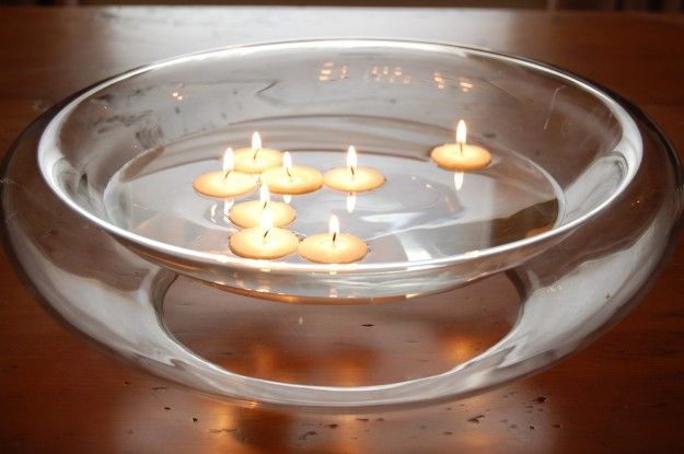 Make floating candles: Turn tea light over and seal bottom with wax (light a taper candle and let the hot wax drip onto the bottom of the tea light). This stops water from getting into the candle wick, so it won't go out when its in the water. Candles should now float in water - pretty