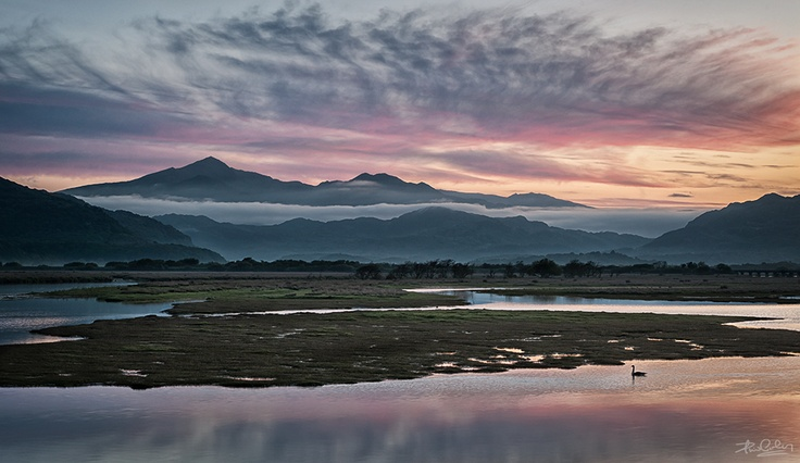 The Cob, Porthmadog, North Wales With the early morning mists still drifting through the valleys, the dawn starts to light up the skies over Snowdonia as the Glaslyn river reflects a peaceful calm.
