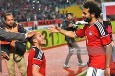 Egypt's Ramadan Sobhi (L) celebrate his goal against Nigeria with his teammate Mohamed Salah (R) during their African Cup of Nations group G qualification football match between Egypt and Nigeria at the Borg el-Arab Stadium in Alexandria on March 29, 2016. / AFP / KHALED DESOUKI