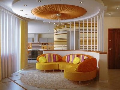 Love the curvy room divider and sofa plus what a wow lighting feature