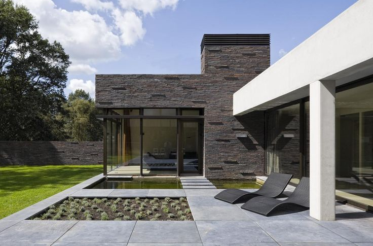 modern concrete structure meets the brick wall - House at the edge of a forest by Hilberink Bosch #Architecten