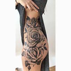Resultado de imagem para tatuagem feminina na perna de rosa