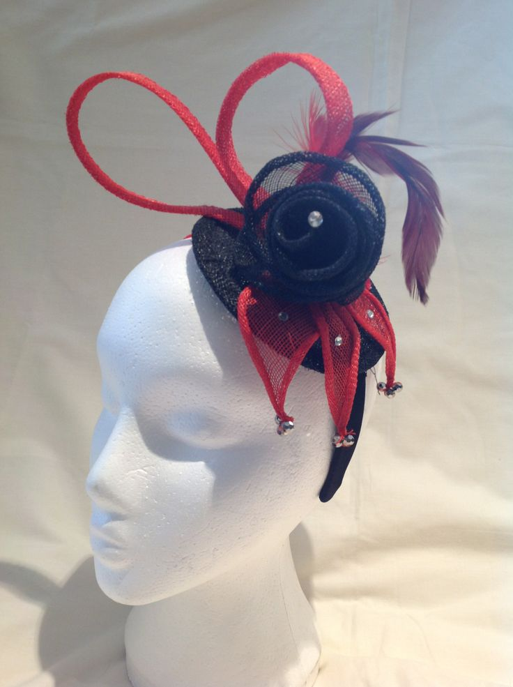 The Davina is a medium fascinator on a black head band with a black sinamay base and flower surrounded by red sinamay detailing, matching feathers and a diamante finish. $80 AUD.