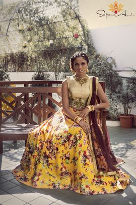 Mehendi Outfits - Floral Print Lehenga | WedMeGood | Yellow Floral Mehendi Lehenga with Beige Embroidered Blouse and Maroon Dupatta #wedmegood #lehenga #floral #yellow