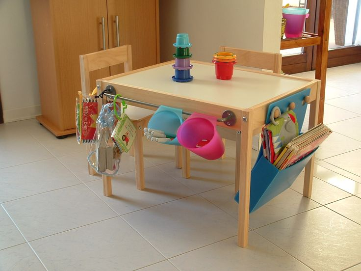 The towel bar and hooks really boost the functionality of this kids' table. Another idea: attaching utensil drying racks for holding markers and crayons