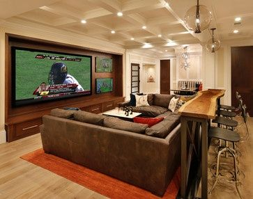 Man cave. Love the table and bar stools behind the couch! 3 t.v.s? seriously?
