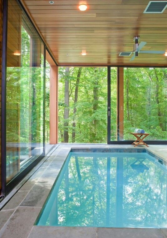indoor pool with big sliding glass