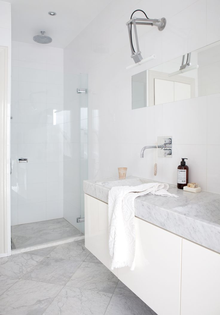I spy with my little eye a linear drain peeking out from the shower in this photo!