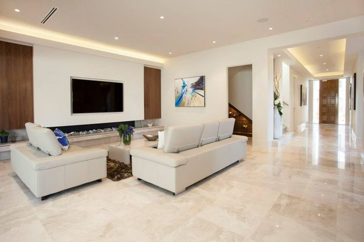 From the entry, the home opens up to a generous living area, full of contemporary charm...