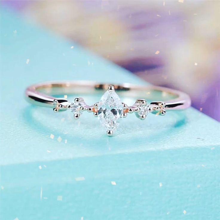 When less is more. Our Chelsea Ring features a marquise cut CZ crystal framed by a cluster of smaller crystals. Dainty and elegant this ring will make a beautiful addition to your collection. Available in silver or rose gold. ring selfie ring silver solitare ring fake engagement rings simple jewelry ring rings simple engagement ring simple