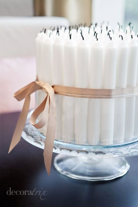 Candle Cake: Blowing out 50 candlesticks (bound together with a sweet blush ribbon!) just packs an additional touch of drama. Click through for my birthday party ideas!