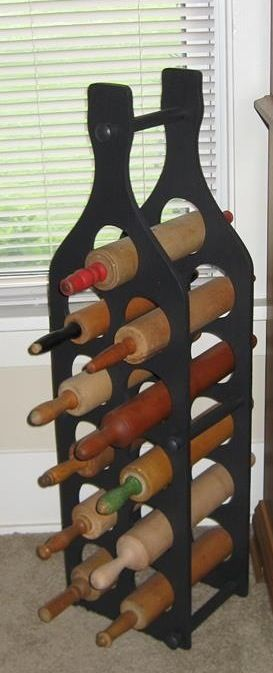 Rolling pins in a wine rack for those of us who don't drink wine.
