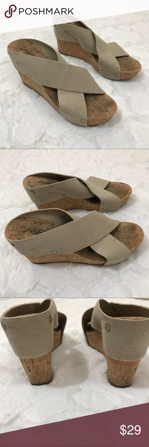 "Lucky brand wedge miller 2 canvas stretch cork This stylish cork sandal features a simple crossover vamp and a high wedge heel.  MILLER2-NAT Brand Color: Natural (Main Color: Beige) Material: Canvas Measurements: 4"" heel Width: B(M) Lucky Brand Shoes Wedges"