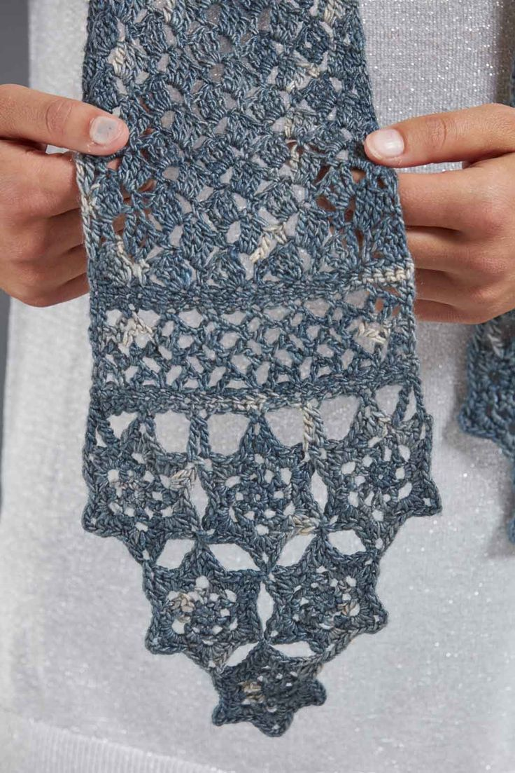 Cascading snowflakes edge a lacy scarf that adds a cool winter look to both formal and informal attire. The snowflakes are made first with a join-as-you go technique. Will someone on your list be the lucky recipient of this scarf this winter...or will you keep it for yourself? See more in Love of Crochet, Winter 2017!