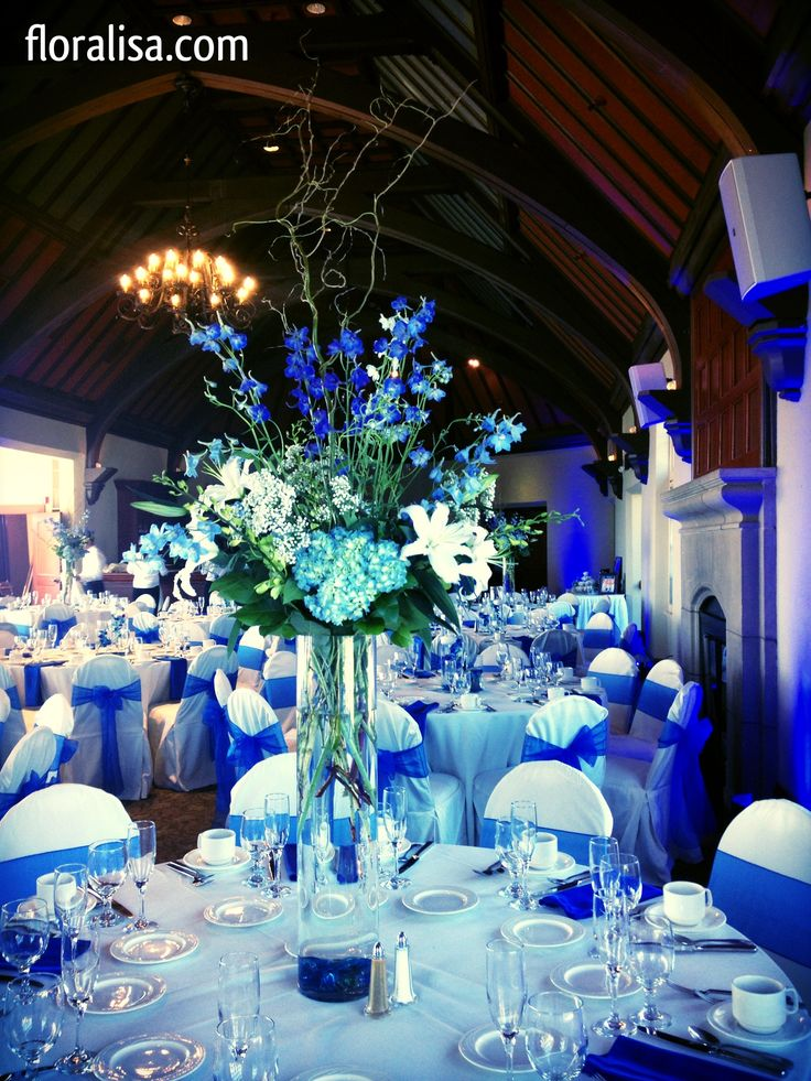 Gorgeous blue wedding table centerpieces by floralisa