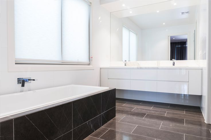 Ensuite design. Add a touch of style and elegance with feature flooring such as Pietra Grigio as pictured, wall hung vanity and translucent blinds for privacy.  www.emmedesigns.com.au