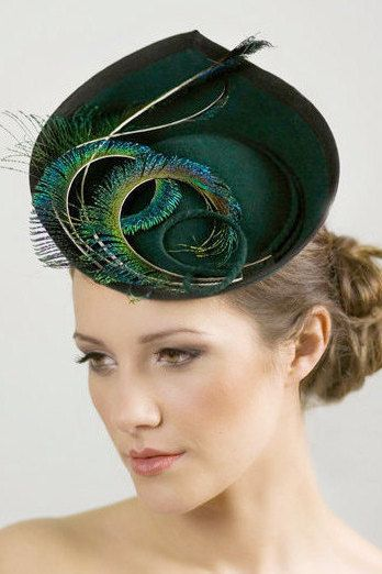 Elin is an elegant hat, with hand curled peacock feather spears. This stylish hat has a wired edge to ensure the hat keeps good shape over