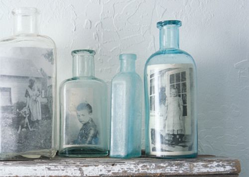 Bottle picture frames... So simple and looks so great with old photos