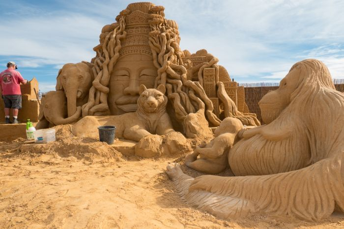 Lead sculptor Kevin Crawford continues to work on the sand creations.