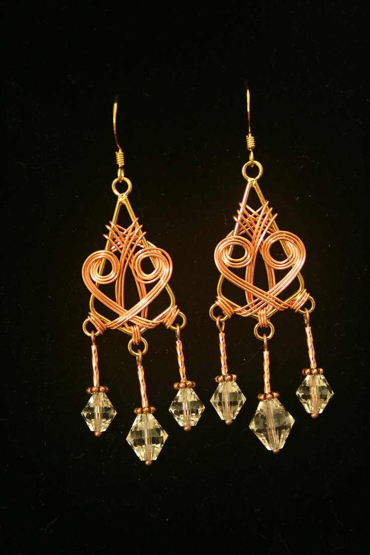 Triangular brass and copper wire wrapped earrings with vintage handcut crystal beads.