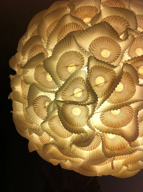 DIY lamp. Layered cupcake liners glued to a white paper lantern!