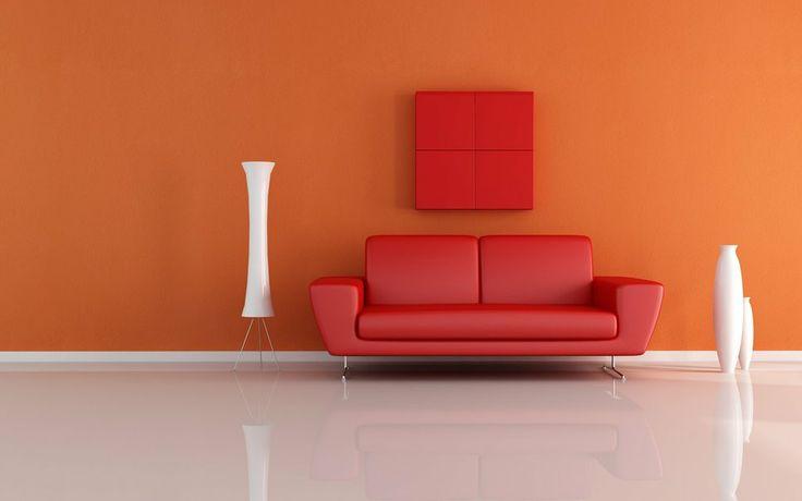 Red sofa with orange background