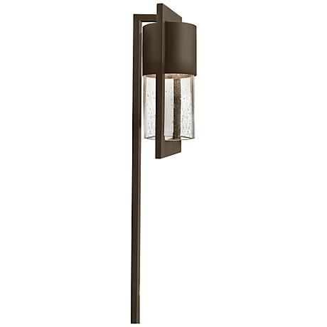 Clear, seedy glass offers a boost of style in this modern path light from Hinkley Lighting.