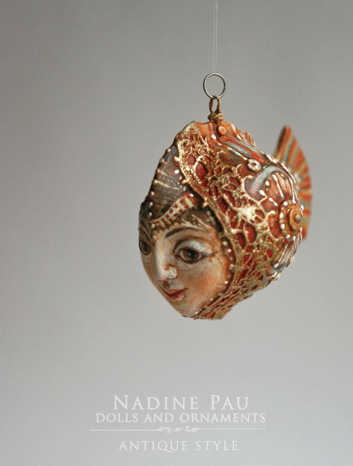 "by Nadine Pau. Christmas ornaments. "" Little gold fish"" Papier mache, oil patina varnish. Sold #christmasornaments #nadinepau"