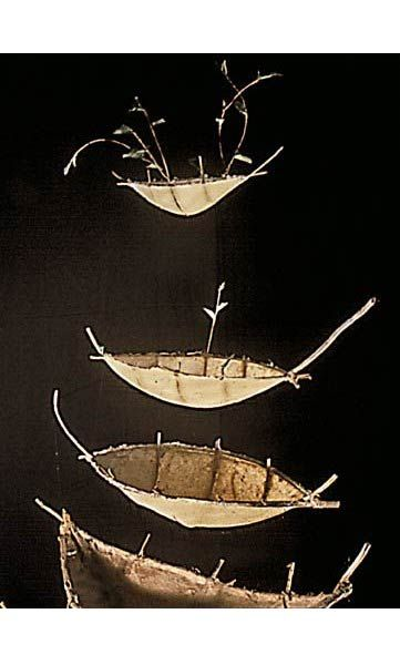 "Nesting Boats by Catherine Nash  Cast HMPaper of varied fibers: cedar bark, torch ginger grass,gampi and kozo fibers, branches, straw. Top two boats ""sprout"" green gampi paper leaves. 6.5 X 2 X 4 ft.Des Sculpture"