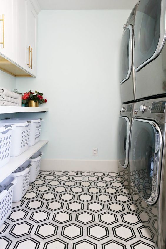 Double washer/dryer and LOTS of baskets. Dream laundry room!