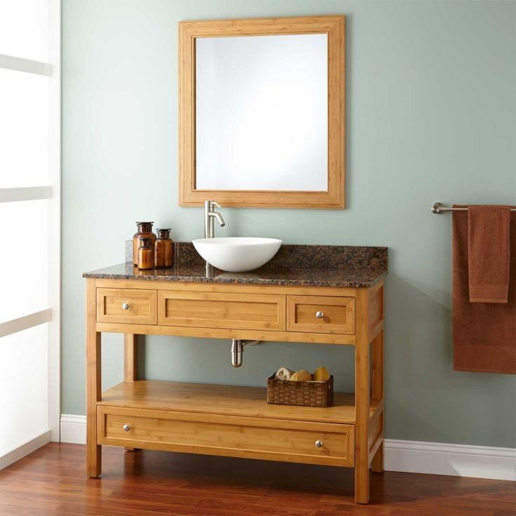 Three Drawers Narrow Bathroom Vanity Table Made Of Wood In Natural Finish Having Three Drawers Using