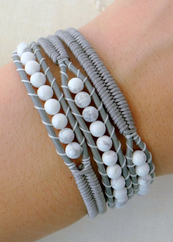 This beaded leather wrap bracelet is made with white howlite beads, grey leather, grey Chinese knotting cord and a silver button clasp. The beaded