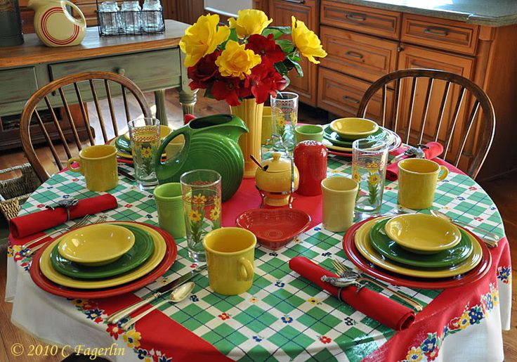 LOVE this table scape. This woman's blog is disgusting, btw.  I want to know WHERE she keeps all her sh*t. *sigh*