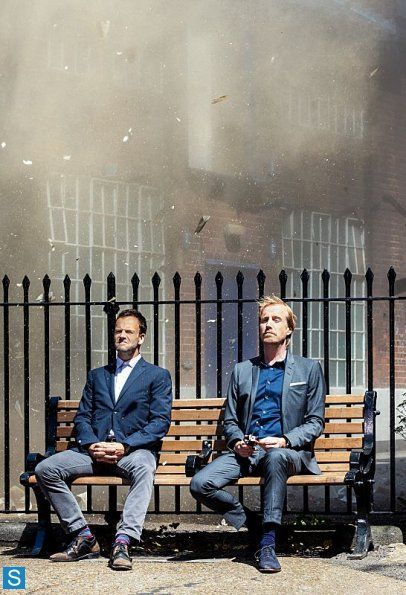 Elementary - Episode 2.01 Sherlock and Mycroft. I can already tell this is going to be awesome. Looks like Mycroft just blew up something behind them. The day in the life of the Holmes brothers. Haha!