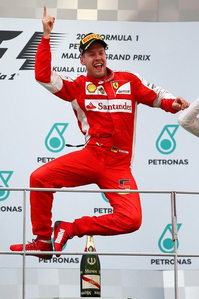 Sebastian Vettel of Germany and Ferrari celebrates on the podium after winning the Malaysia Formula One Grand Prix at Sepang Circuit on March 29, 2015 in Kuala Lumpur, Malaysia.