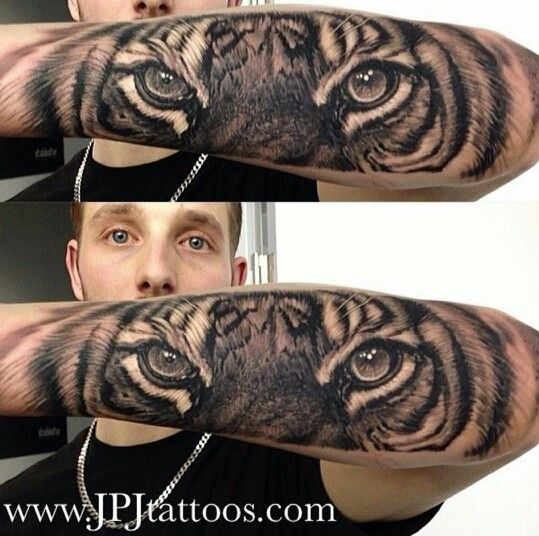 Realistic tiger eyes tattoo on a forearm... Pretty good fit, I might want something similar.