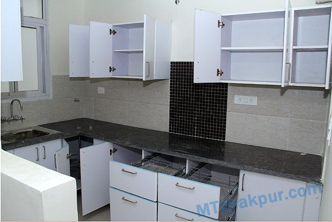 a beautiful moduller kitchen  with racks .to access and manage all kitchen stuff easily .