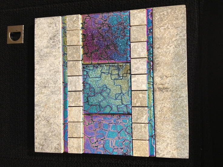 Coatings by Sandberg features an aviation industry inspired coating on their iridescent tile that resists scratches. #Coverings2013