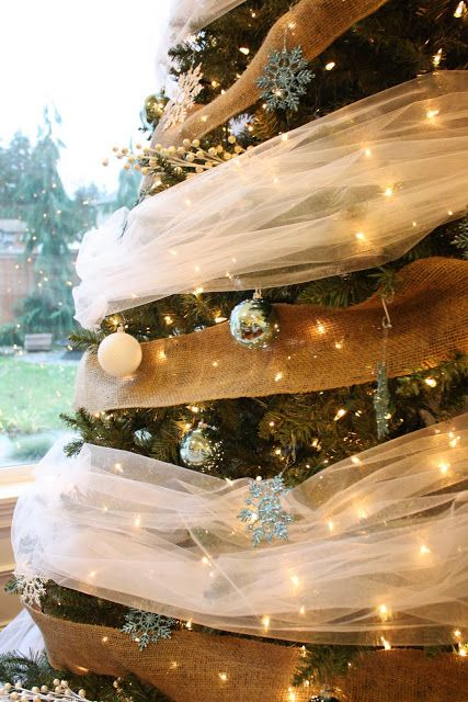 dressed on a dime: burlap and tulle lighted christmas tree. Pretty. we used this fabric as decor for our weddingday and we have A LOT of leftovers. I wil do this :)