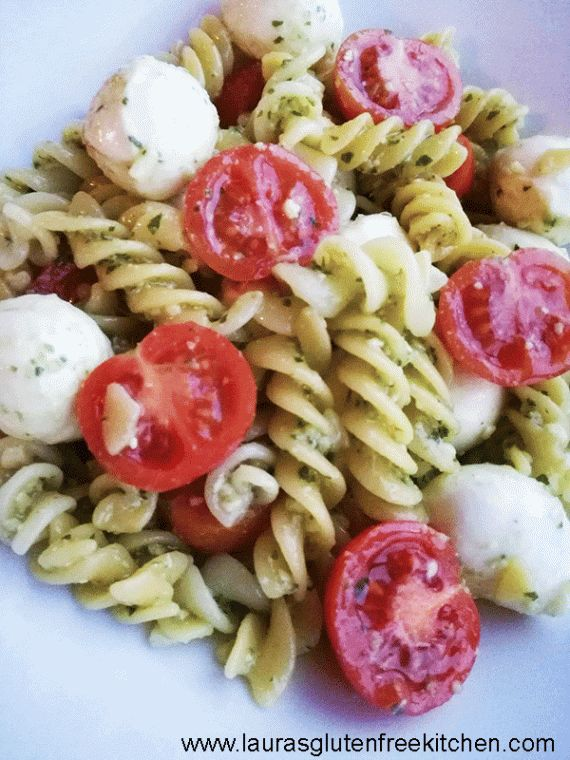 Gluten Free Caprese Pasta Salad --- Light and refreshing Gluten Free Caprese Pasta Salad made with fresh mozzarella, tomatoes, pesto, olive oil and spices all tossed together with a delicious gluten free fusilli pasta.