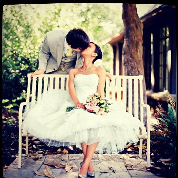 Wedding photography idea- if there is a bench available- would be cute with a bright colored shoe