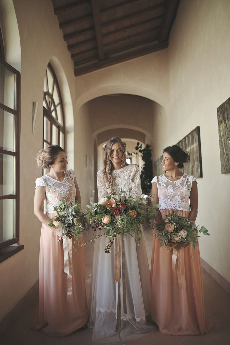 gorgeous bridesmaids in lace crop tops and peach tulle skirts